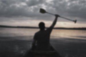 man-lake-canoe
